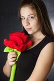 Ragazza con una rosa Fotografia Stock