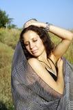 Ragazza con una sciarpa Fotografie Stock