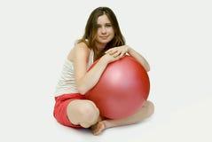 Ragazza con una sfera Fotografie Stock