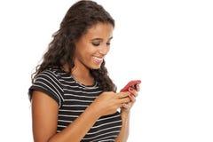 Ragazza con uno smartphone Fotografia Stock