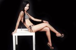 Ragazza dai capelli lunghi del bikini Immagine Stock