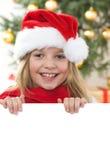 Ragazza dei capelli abbastanza biondi con il cappello della Santa e il comf rosso Fotografia Stock Libera da Diritti