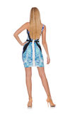 Ragazza dei capelli biondi in mini vestito blu isolato sopra Fotografie Stock