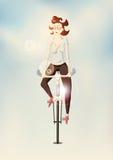 Ragazza dei pantaloni a vita bassa che guida una bici sul fondo confuso Illustrazione di vettore Fotografia Stock Libera da Diritti