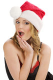 Ragazza del Babbo Natale che fa fronte divertente Fotografie Stock