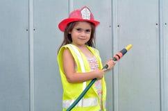 Ragazza del bambino in costume del vigile del fuoco Fotografia Stock Libera da Diritti