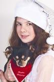 Ragazza del bambino di natale con il cane Fotografie Stock Libere da Diritti