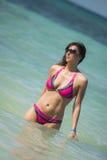 Ragazza del bikini in acqua Fotografie Stock