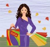 Ragazza del brunette di acquisto di autunno Immagine Stock