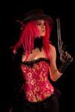 Ragazza del cabaret in pistola dentellare della holding del corsetto Fotografia Stock