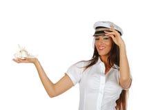 Ragazza del marinaio con le coperture del mare Fotografie Stock