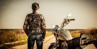 Ragazza del motociclista Immagini Stock