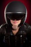 Ragazza del motociclista in un casco Immagini Stock