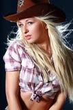 Ragazza del rodeo che porta un cappello di cowboy Fotografia Stock