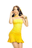 Ragazza del sesso in un vestito giallo Fotografia Stock