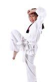Ragazza del taekwondo dell'asiatico sopra con fondo Fotografie Stock