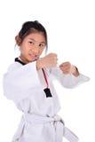 Ragazza del taekwondo dell'asiatico su fondo bianco Fotografia Stock