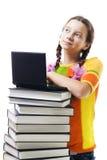 Ragazza dell'adolescente con i libri ed il sorriso del computer portatile Fotografia Stock