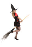 Ragazza dell'adolescente nella strega di Halloween con la scopa Immagine Stock Libera da Diritti
