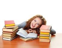 Ragazza dell'allievo con i libri in aula Immagini Stock Libere da Diritti