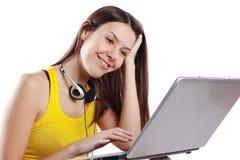 Ragazza dell'allievo con il computer portatile Immagini Stock Libere da Diritti