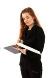 Ragazza dell'allievo di formazione con il libro Immagini Stock