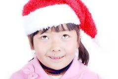 Ragazza dell'Asia con il cappello di natale fotografia stock libera da diritti