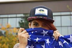 Ragazza della bandiera americana fotografia stock