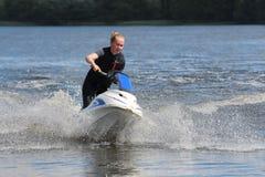 Ragazza della foto di azione sul jet ski Fotografie Stock