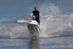 Ragazza della foto di azione sul jet ski Fotografia Stock Libera da Diritti