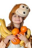 Ragazza della scimmia con frutta Fotografia Stock Libera da Diritti