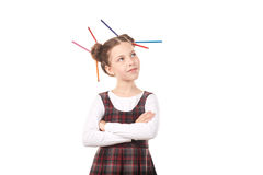 Ragazza della scuola con le matite in capelli Immagine Stock Libera da Diritti