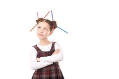 Ragazza della scuola con le matite in capelli Fotografia Stock