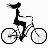 Ragazza della siluetta sulla bici Fotografie Stock