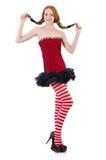 Ragazza della testarossa in vestito ed in calze rossi Fotografie Stock Libere da Diritti