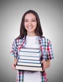 Ragazza dello studente con molti libri su bianco Fotografie Stock