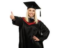 Ragazza dello studente graduato con il pollice su Fotografia Stock