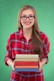 Ragazza dello studente su fondo verde Immagini Stock