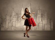 Ragazza di acquisto con le borse in città tirata Fotografia Stock Libera da Diritti