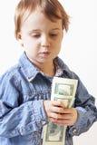Ragazza di affari con i dollari Successo, gestione di ricchezza Humorou Immagine Stock