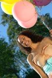 Ragazza di compleanno con gli aerostati Fotografia Stock