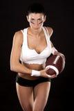 Ragazza di football americano Fotografia Stock