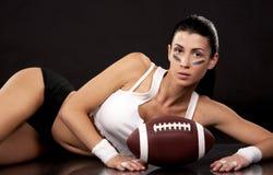 Ragazza di football americano Fotografie Stock Libere da Diritti