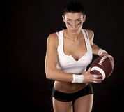 Ragazza di football americano Fotografie Stock