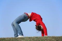 Ragazza di ginnastica del ponticello Fotografie Stock
