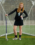 Ragazza di lacrosse con l'atteggiamento Fotografia Stock Libera da Diritti