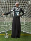 Ragazza di lacrosse con l'atteggiamento Fotografie Stock Libere da Diritti