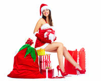 Ragazza di Natale dell'assistente di Santa con presente. Fotografie Stock