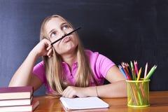 Ragazza di pensiero alla scuola Immagine Stock Libera da Diritti