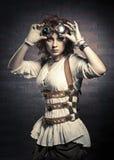 Ragazza di Redhair con gli occhiali di protezione dello steampunk Fotografie Stock Libere da Diritti